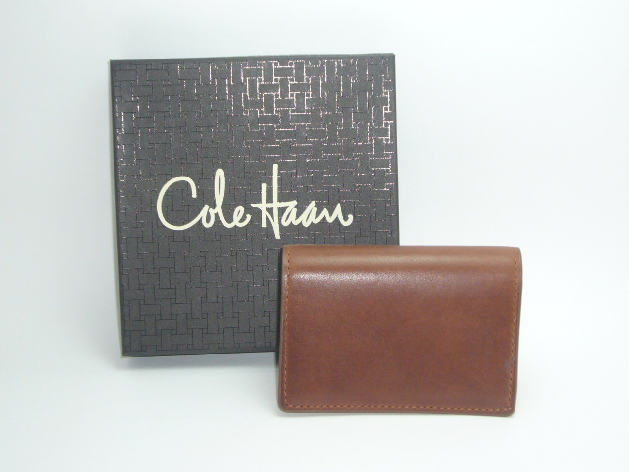 the latest 1aa40 bda52 Cole Haan Leather Gusset Card Case Paladino Collection...Papaya